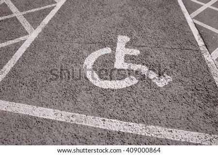 Disabled Parking Sign in Urban Setting in Black and White Sepia Tone