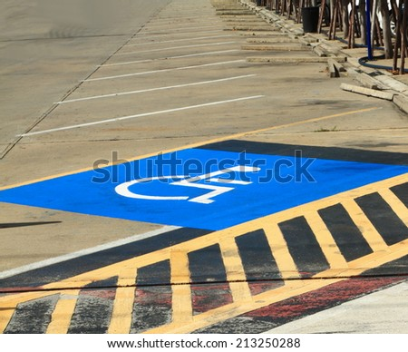 Disabled parking sign on the floor. - stock photo