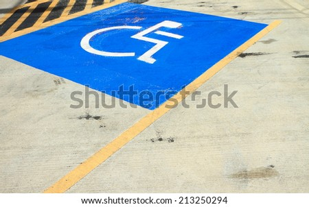 Disabled parking sign on the floor.