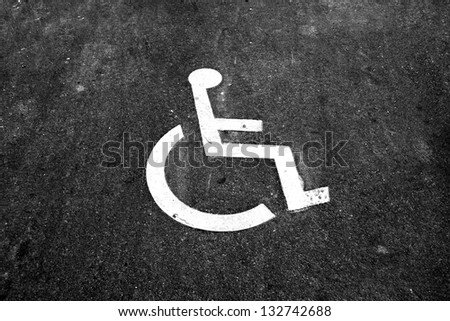 disabled parking sign - outdoors - on an asphalt background - stock photo