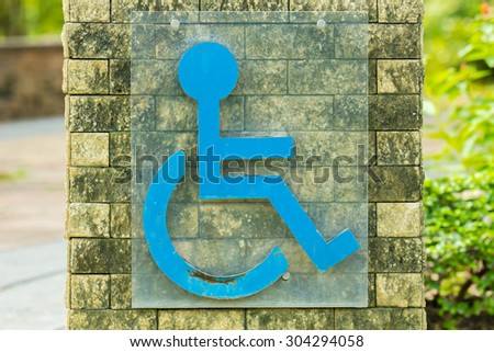 Disabled permit sign in the garden.
