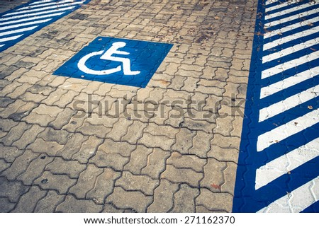 Disabled permit sign on parking lot - stock photo
