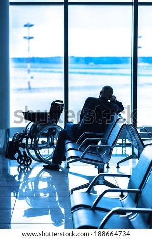 Disabled person in the interior of the airport - stock photo