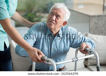 Disabled senior man being in nursing home - stock photo