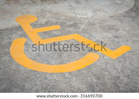 disabled sign on asphalt - stock photo