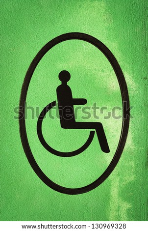 disabled sign on green grunge wall - stock photo