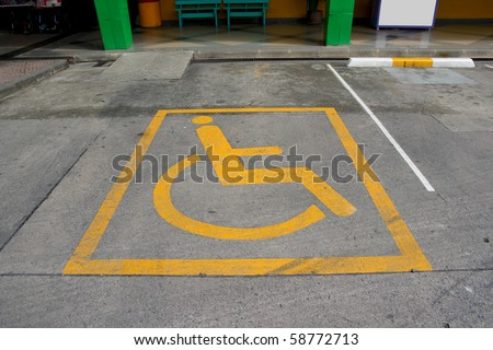 disabled symbol on floor - stock photo
