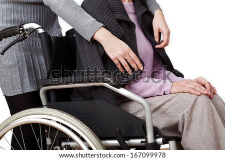 Disabled woman is cared by her daughter - stock photo