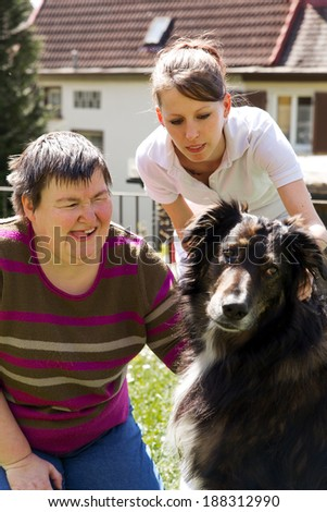 disabled woman is making a animal-assisted therapy - stock photo