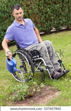 disabled young man in wheelchair in gardening