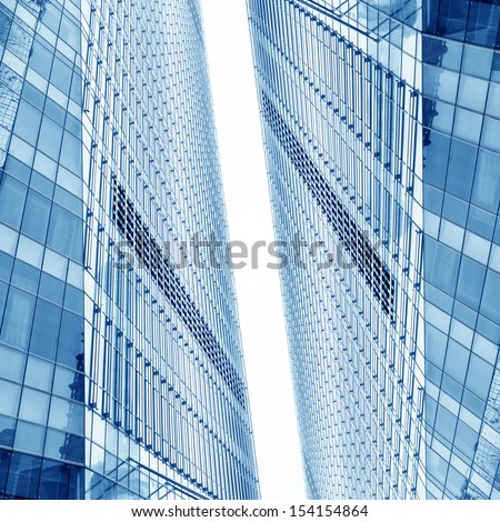 disappearing glass office buildings, wide angle view - stock photo