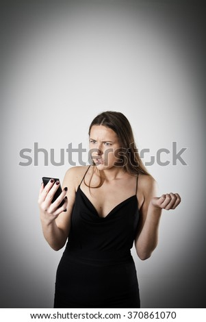 Disappointed and irritated woman talking on the phone. . - stock photo