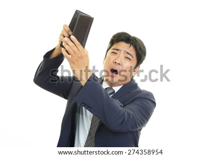 Disappointed Asian man - stock photo