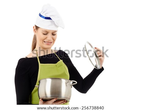 Disappointed caucasian woman cook with a stainless steel pot, isolated on white background - stock photo