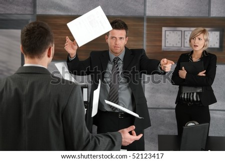 Disappointed director rejecting business report, throwing away papers, pointing out of frame. - stock photo