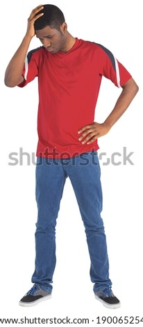 Disappointed football fan looking down on white background - stock photo