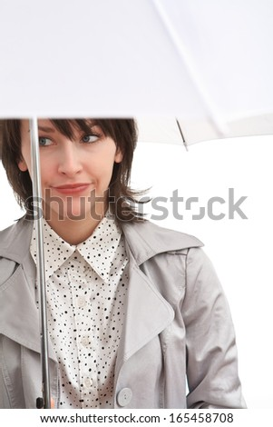 disappointed girl in grey coat under white umbrella  - stock photo