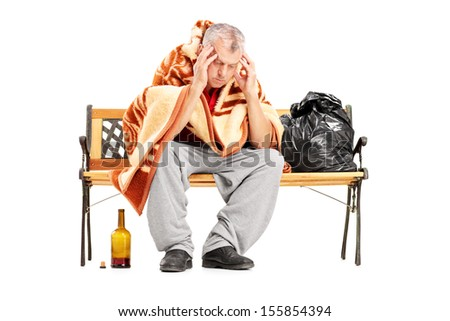 Disappointed homeless mature man sitting on a wooden bench isolated on white background - stock photo