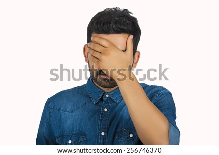 Disappointed Man Covering Face With Hand - stock photo