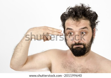 Disappointed Man Pointing A Finger Gun At His Head - Hopelessness - Unemployment -  Loneliness - Isolated On White / Man - Hopelessness - Unemployment -  Loneliness - stock photo
