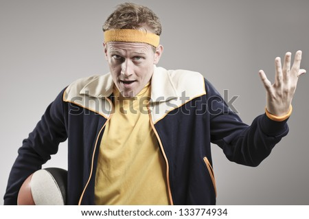 Disappointed Retro Gym Coach Looking Upset - stock photo