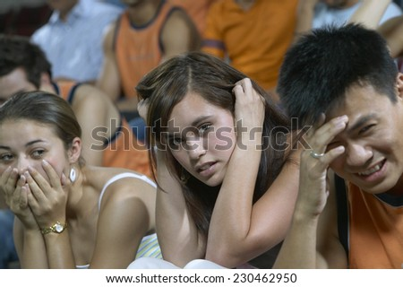 Disappointed Spectators at a Sporting Event - stock photo