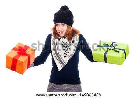 Disappointed winter woman holding two presents, isolated on white background. - stock photo