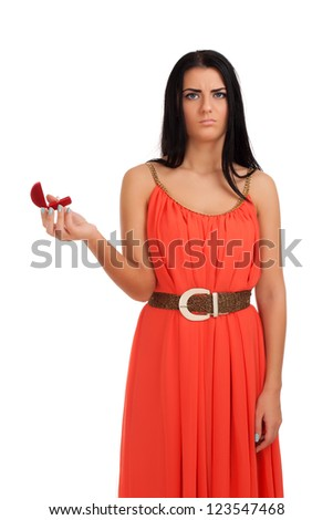 Disappointed woman with engagement ring in box - stock photo