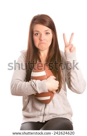 Disappointment - This is an image of a cute female football fan who is sad that her team just lost the game. Shot on an isolated white background. - stock photo