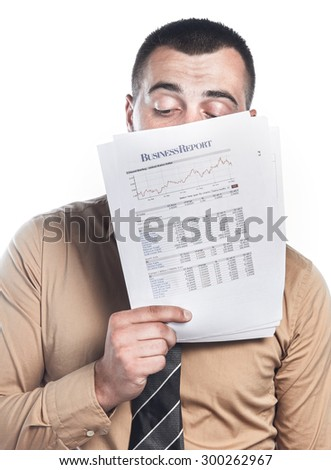 Disapponited businessman reading papers. Business crisis concept. Isolated on white background, close up
