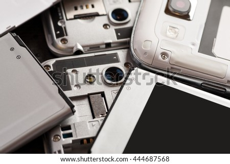 Disassembled cell phone with visible parts inside, selective focus