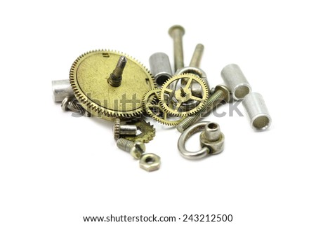 disassembled clockwork on a white background - stock photo