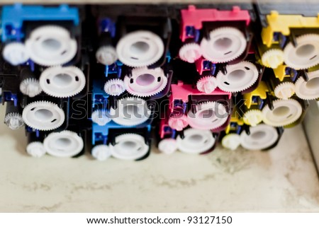 disassembled colour cartridges of color printer - stock photo