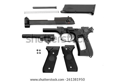 Disassembled handgun on white background. Seperate parts handgun. Pistol Part. - stock photo