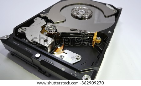 Disassembled Hard drive. The head of the hard disk.