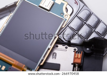 Disassembled mobile phone - close up - stock photo