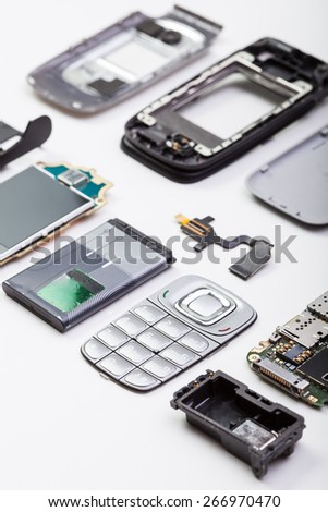 Disassembled mobile phone on white background