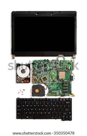 Disassembled open computer isolated on white with electronic parts: motherboard, hdd, keyboard, monitor (with blank screen) - stock photo