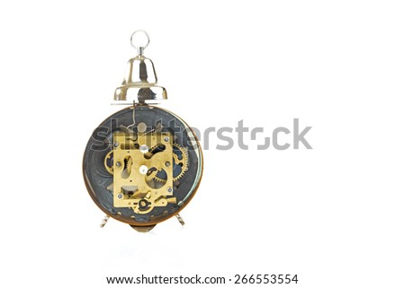 Disassembled vintage alarm clock isolated on white  - stock photo