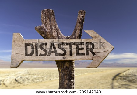 Disaster wooden sign with a desert background - stock photo
