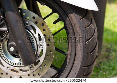Disc brake of eco motorcycle, , scooter motorcycle background - stock photo