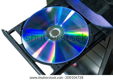 Disc instert to DVD or CD player - stock photo