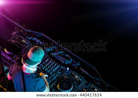 Disc jockey mixing electronic music in club. Shot from aerial perspective. Copyspace for text - stock photo