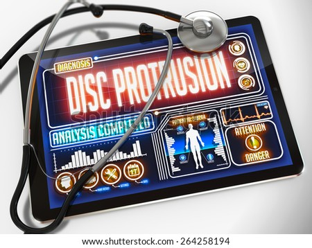 Disc Protrusion - Diagnosis on the Display of Medical Tablet and a Black Stethoscope on White Background. - stock photo