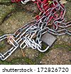 Discarded chains on the ground square - stock photo