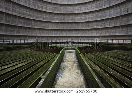 Discarded cooling tower of a nuclear plant - stock photo