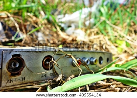 discarded electronic appliances free standing in nature - stock photo