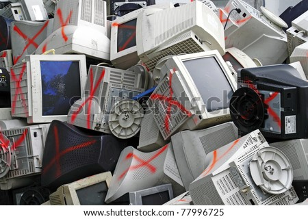 Discarded obsolete computer monitor and equipment being processed for recycle. - stock photo