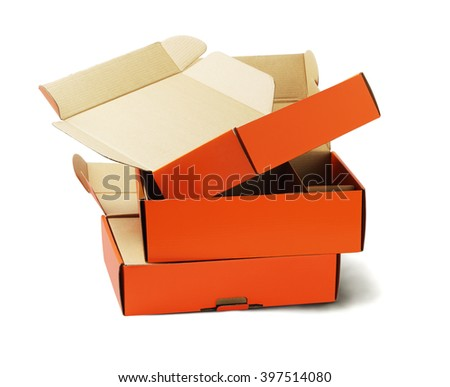 Discarded Orange Product Package Boxes for Recycling on White Background  - stock photo