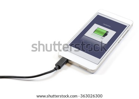 Discharged cell phone with charger isolated on white background